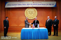 Hanyang Cyber University Chancellor shakes hands with Anaheim University Dean