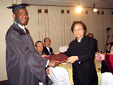 Dr. Kurokawa presents diploma to AU MBA Graduate Michael Paul